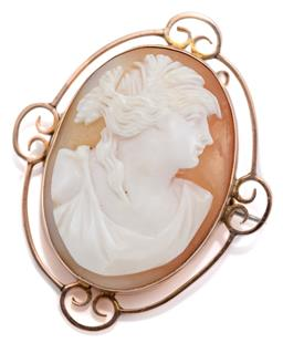 Sale 9095 - Lot 371 - AN ANTIQUE 9CT GOLD CAMEO BROOCH; carved shell cameo featuring a classical portrait collet set to wire and scroll frame, 41 x 33mm,...