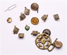 Sale 9153 - Lot 53 - A collection of pendants inc stone examples together with Small collection of pins and badges
