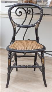 Sale 8902H - Lot 83 - An ebonised and mother of pearl inlaid occasional chair with canework seat, height of back 80cm