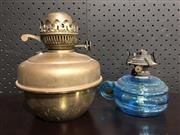 Sale 9034 - Lot 1061 - Brass Kerosene Lamp together with a Blue Glass Example