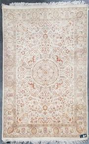 Sale 8809 - Lot 1045 - Persian Woollen Rug with Floral Motifs on Cream Field (190 x 125cm)