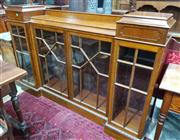 Sale 8939 - Lot 1093 - Edwardian Maple Dwarf Breakfront Bookcase, with raised pedestal section, four astragal doors & plinth base. H: 116, W: 175, D: 35cm