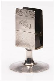 Sale 9052 - Lot 327 - Chinese export sterling silver matchbox holder, hand beaten with applied gold (H: 9cm)