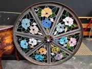 Sale 8724 - Lot 1001 - Cast Iron Wagon Wheel with Lead Light Interior