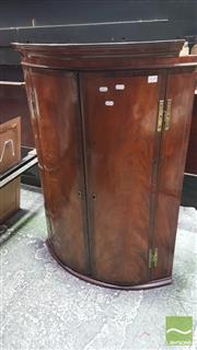 Sale 8375 - Lot 1028 - Georgian Flame Mahogany and String Inlaid Bow-Front Corner Cupboard