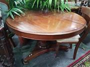 Sale 8598 - Lot 1067 - 19th Century Cedar Supper Table, the round top above a  faceted pedestal, on a triform base