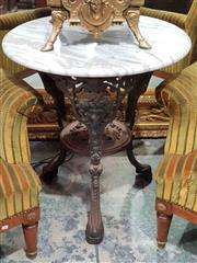 Sale 8939 - Lot 1064 - Victorian Style Cast Iron Pub Table, with round white marble top, the legs with mask heads and joined by a sheld. H: 67 x Dia: 60 cm