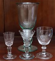 Sale 9058H - Lot 93 - A group of four handblown glasses to include one green and three clear examples. tallest 19cm