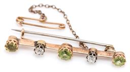 Sale 9160 - Lot 356 - AN ANTIQUE PERIDOT AND DIAMOND BAR BROOCH; 9ct gold knife edge bar crown claw set with 3 round cut peridots (ware) and 2 Old mine cu...