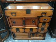 Sale 8666 - Lot 1038 - Japanese Pine Tansu Chest, with six drawers around a pair of sliding doors, the lower slatted doors enclosing further drawers & a shelf