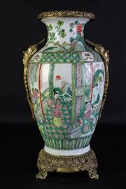 Sale 8989 - Lot 13 - Famille Verte Ormolu Mounted Vase, decorated with figures and horse in a garden setting, (H:41cm)