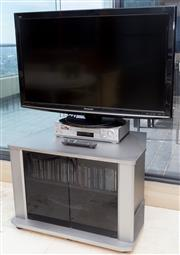 Sale 8593A - Lot 73 - A Panasonic 42 flat screen TV on stand, together with a SONY video player, with TV unit and CDs, etc