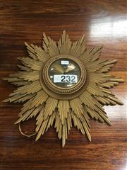 Sale 8723 - Lot 1031 - Meramec Star Burst Wall Clock