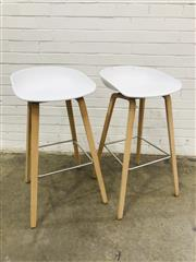 Sale 9092 - Lot 1023 - Pair of timber based stools with moulded plastic top by HAY (h:58 x w:43 x d:43cm)
