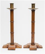 Sale 8575J - Lot 73 - A pair of ecclesiastical oak and brass candlesticks, each height 38cm