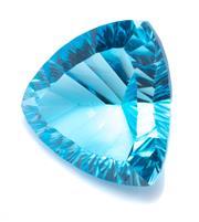 Sale 8991 - Lot 338 - AN UNSET 28.57CT BLUE TOPAZ; millennium trilliant cut stone, 19.27 x 19.38 x 11.55mm.
