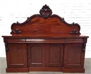 Sale 9085 - Lot 1026 - Victorian Mahogany Breakfront Sideboard, with carved shaped back, above three frieze drawers & four arched panel doors - key in offi...