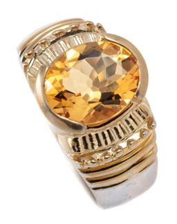 Sale 9213 - Lot 322 - A SILVER CITRINE RING; gilt top set with an oval cut citrine of approx. 2.14ct, top width 11.5mm, size L, wt, 5.68g.