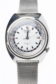 Sale 8293 - Lot 322 - A SEIKO GENTS WORLD TIME AUTOMATIC WRISTWATCH; ref; 6117-6400 in stainless steel with centre seconds, date, rotating outer Capitals...