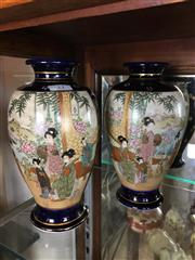 Sale 8730B - Lot 21 - Pair of Satsuma Vases Depicting Village Scenes H: 21.5cm