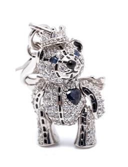 Sale 9246J - Lot 335 - A SILVER STONE SET  PRINCESS BEAR PENDANT; zirconia and blue sapphire set articulated bear with crown and wings with sapphire hear...