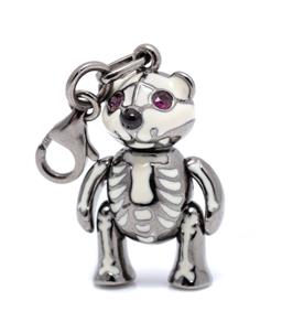Sale 9246J - Lot 337 - AN ENAMELLED SILVER AND STONE SET BARE BONES BEAR PENDANT; white enamel on blackened silver with round cut ruby eyes, size 40 x 14...