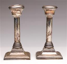 Sale 9104 - Lot 72 - A Pair of hallmarked sterling silver candle sticks (H 17cm)