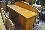 Sale 8390 - Lot 1007 - Victorian Gothic Style Oak Sideboard, with pointed back board & apron, the pedestals with trefoil panel doors