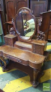 Sale 8402 - Lot 1074 - Victorian Burr Walnut Veneered Dressing Table, with carved brackets, centre compartment & seven drawers raised on cabriole legs