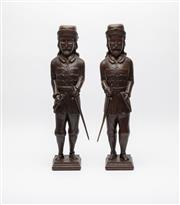 Sale 8697A - Lot 34 - A pair of large antique carved mahogany Spanish Conquistadors each helmeted and uniformed with a hand resting on a sword hilt the ot...
