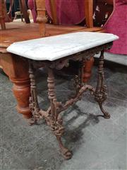Sale 8925 - Lot 1021 - A marble topped iron based table of diminutive size