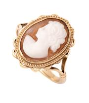Sale 9074 - Lot 395 - A VINTAGE 9CT GOLD CAMEO RING; set with a 14 x 10mm carved shell cameo featuring a female portrait to twist and scalloped frame, siz...