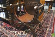 Sale 8390 - Lot 1010 - Heavily Carved Oak Savonarola Style Armchair, the back with monogram & foliage, having mask to front & turned stretchers
