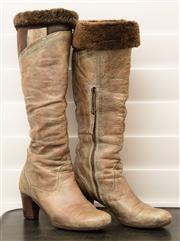 Sale 8902H - Lot 132 - A pair of Italian distressed leather fur lined knee high boots, tan and brown