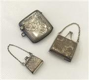 Sale 8436A - Lot 17 - A group of three sterling silver items comprising two miniature handbags and a vesta case, various marks.