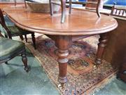 Sale 8814 - Lot 1088 - Victorian Mahogany Extension Dining Table, with two leaves & winding mechanism, raised on turned legs on castors (small section of m...