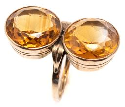 Sale 9115 - Lot 324 - A VINTAGE 14CT GOLD CITRINE COCKTAIL RING; rub set with two round cut citrines either side of band (split), 2 citrines total approx....