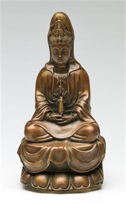 Sale 9246 - Lot 86 - A bronze seated figure of Guanyin on lotus base, Height 22cm.