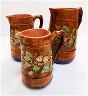 Sale 8362A - Lot 9 - A graduated set of 3 antique English majolica jugs, heights 16 - 21 cm tall, some small chips