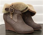 Sale 8902H - Lot 143 - A pair of Italian, fur lined brown leather wedge ankle length boots, size 37