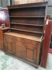Sale 8939 - Lot 1081 - Probably Late Georgian Pine Dresser, the open shelves, above an arrangement of six drawers with later brass handles, flanking two pa...
