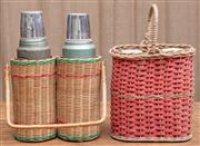 Sale 8984H - Lot 81 - A pair of Alladin Stanley thermos flasks together with a cane bottle carrier. Height 37cm and another ACME basket with flasks.