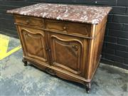 Sale 9048 - Lot 1039 - Late 19th Century French Walnut Buffet, with mottled brown marble top, above two quarter veneered drawers & two doors, with shell ca...
