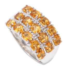 Sale 9213 - Lot 308 - A SILVER CITRINE RING; 11.6mm wide ring set with 15 oval cut citrines, size Q, wt. 4.73g.