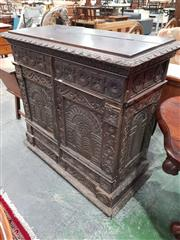 Sale 8774 - Lot 1031 - 17th Century Style Heavily Carved Oak Cabinet, with secret hinged top compartment & two arcaded panel doors below