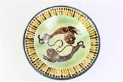 Sale 8802 - Lot 200 - A Sri Lankan pottery fruit bowl, with twin lions