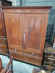 Sale 8814 - Lot 1069 - Regency Style Mahogany Wardrobe, with two panel doors with attached flase drawers, two actual drawers below and splayed bracket feet...