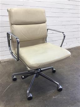 Sale 9151 - Lot 1005 - Eames style office chair with white leather upholstery (h90 x w80 x d60cm)