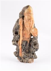 Sale 8855D - Lot 623 - A small intricately carved stone figure of a Chinese elder, height 10cm