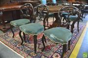 Sale 8390 - Lot 1039 - Set of Six Victorian Carved Balloon Back Chairs, with blue velvet seats & cabriole legs